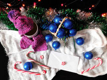 New Year composition. Made of hot drink, Christmas balls , Christmas tree decorations and candy canes stock photo