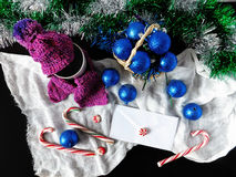 New Year composition. Made of hot drink, Christmas balls , Christmas tree decorations and candy canes royalty free stock images