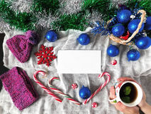 New Year composition. Made of hot drink, Christmas balls , Christmas tree decorations and candy canes royalty free stock photos
