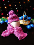 New Year composition made of mug, knitted kit and Christmas tree decorations. A mug for a hot drink decorated with knitted kit surrounded by Christmas stock photo