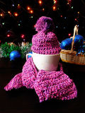 New Year composition made of mug, knitted kit and Christmas tree decorations. A mug for a hot drink decorated with knitted kit surrounded by Christmas stock image