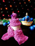 New Year composition made of mug, knitted kit and Christmas tree decorations. A mug for a hot drink decorated with knitted kit surrounded by Christmas stock images