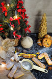 New Year composition. With number 2017,new year tree, biscuits, sugar, cinnamon sticks and chocolate candies Stock Photos