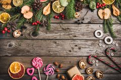 New Year composition of dried fruits on a wooden table. Christmas background. Flat lay.Top view Stock Photos