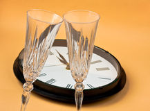 New year concept. Clock with champagne flutes for new year Royalty Free Stock Photos
