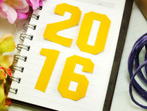 New year concept beautiful gifts with flowers and decorative rope with notebook Stock Photos