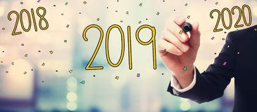 2019 new year concept with businessman. On blurred abstract background royalty free illustration