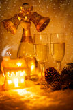 New Year concept with champagne and glasses on golden background Stock Photography