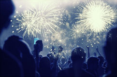 Free New Year Concept - Cheering Crowd And Fireworks Stock Images - 62266084