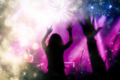 New Year concept - cheering crowd and fireworks Stock Photo