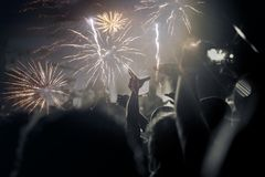 New Year concept - cheering crowd and fireworks Royalty Free Stock Image