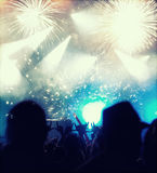 New Year concept - cheering crowd and fireworks Royalty Free Stock Photography