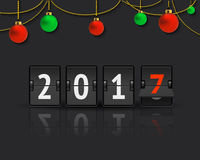New Year concept with christmas balls. Flip board clock changing to 2017. Analog scoreboard flip calendar changes to another year. Digital countdown timer with Stock Images