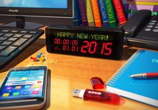 New Year 2015 concept. Creative abstract New Year 2015 beginning celebration business concept: macro view of digital alarm clock with Happy New Year! message on Stock Photo