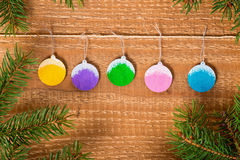 New Year concept of decorated painted balls and twigs pine tree Stock Photo