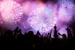 New Year concept. Fireworks and cheering crowd celebrating the New year Royalty Free Stock Images