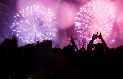 New Year concept. Fireworks and cheering crowd celebrating the New year Royalty Free Stock Image