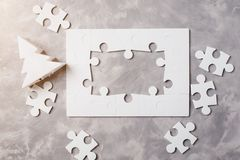 New year concept . Frame of Jigsaw Puzzle on grey concrete background. New year concept . Frame of Jigsaw Puzzle on the grey concrete background Stock Photos