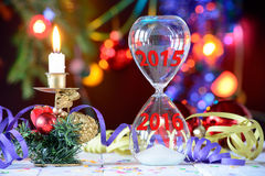 New Year 2016 concept with hourglass. And Christmas decoration Royalty Free Stock Images