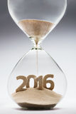 New Year 2016. Concept with hourglass falling sand taking the shape of a 2016 Royalty Free Illustration