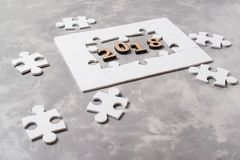 New year concept 2018. Jigsaw Puzzle on grey concrete background. New year concept 2018. Jigsaw Puzzle on the grey concrete background Royalty Free Stock Photos