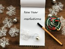 New Year Concept. New Year Resolutions. Planning. Goals. White Notebook Sheet. List Of Resolutions. Wooden Table And Pen. Christma Royalty Free Stock Image