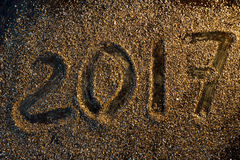 2017 new year concept. Numbers 2017 on the gold sand texture. Royalty Free Stock Image