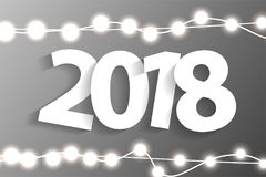 New Year 2018 concept with paper cuted white numbers on realistic Christmas lights decorations on grey background. For greeting cards. Vector illustration Royalty Free Stock Photos