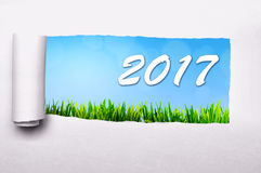 2017 New Year Concept. Paper tearing with 2017 number background. Happy new year concept Stock Photos