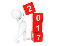 New 2017 Year Concept. Person Placing 2017 New Year Cubes. 3d Re. New 2017 Year Concept. Person Placing 2017 New Year Cubes on a white background. 3d Rendering Royalty Free Stock Image