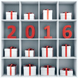 New year concept. 2016 new year concept. Red number characters and gift boxes placed on white square book shelf Royalty Free Stock Photos