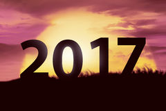 2017 new year concept. Silhouette number on the hill Stock Photo