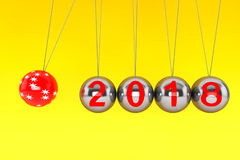 New Year concept. Spheres of Newton with 2018. 3d Rendering. New Year concept. Spheres of Newton with 2018 on a yellow background. 3d Rendering Stock Photos