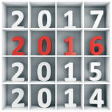 New year concept. 2016 new year concept. White and red number characters placed on white square book shelf Stock Images
