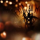 New year congratulations with clock. New year background with clock and bokeh for congratulations Stock Photo