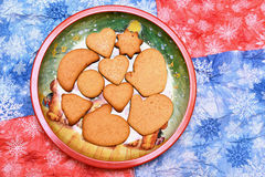 New year cookies. New year and christmas cookies in dish on blue and red napkins Royalty Free Stock Photo