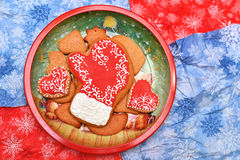 New year cookies. New year and christmas cookies in dish on red and blue background. Horizontal. Free space Royalty Free Stock Images