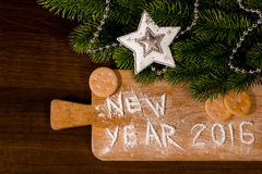 New Year cookies and flour on wooden background Stock Images
