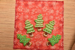 New year cookies. New year trees and christmas cookies. Green on red. Free space Royalty Free Stock Photography