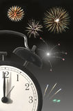 New year countdown. Closeup of a clock face with new years eve fireworks in the background Stock Photos