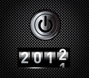 New Year counter. 2012 on black metal pattern with power button Stock Photo