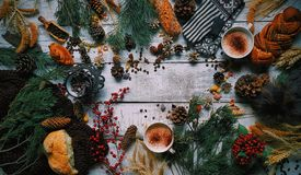 New year, Cozy atmosphere, Scandinavian style, Winter attributes on a white wooden background, Hot drink and buns, Coffee and choc stock photography