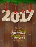 New Year 2017 of crumpled paper against wood background. Paper numbers with torn edge on ribbon. Vector illustration for new years day, christmas, winter holiday Royalty Free Stock Photography