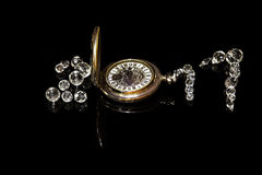 New Year 2017  of crystal beads  and pocket watch, reflections, isolated,  black background. Crystal beads and pocket watch as number 2017,black background Royalty Free Stock Photography