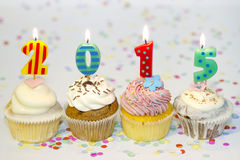 2015 new year cupcakes on abstract colorful background Stock Photography