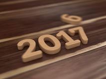 2017 New Year. 3D illustration of 2017 New Year wooden text with depth of field Stock Photos