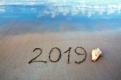 New Year 2019 is coming concept on tropical beach. stock photo