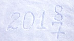 New year date 2018 written in snow background. Stock Photos