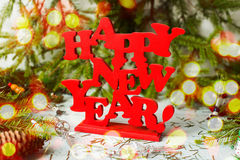 New year decor. Colorful New Year holiday decorations with furtree and toys Stock Photos