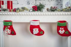 New Year decor on a white fireplace stock photo